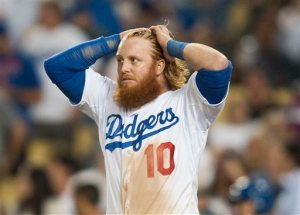 Los Angeles Dodgers' Justin Turner walks away after striking out with a runner on first to end the seventh inning during the Dodgers' 3-2 loss to the New York Mets in Game 5 of the National League Division Series, Thursday, Oct. 15, 2015, in Los Angeles. (Kevin Sullivan/The Orange County Register via AP)